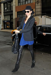 Miranda Kerr headed out for a meeting wearing a pair of black suede ankle boots.
