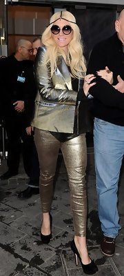 Kesha is never one to shy away from risky pieces like these metallic gold skinny pants.