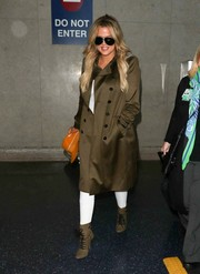 Khloe Kardashian kept it stylish all the way down to her olive-green Balmain lace-up boots.