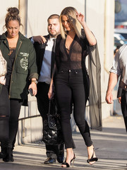 Khloe Kardashian continued the seductive vibe with a pair of Good American skinny jeans that hugged her curves in all the right places!