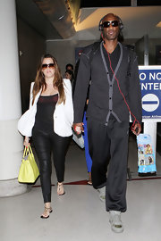 Lamar Odom traveled in comfort in a black and gray cardigan and sweatpants.