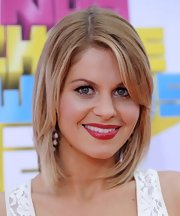 Actress Candace Cameron swiped her lips with a deep shade of red lipstick at the 2011 Kid's Choice Awards.