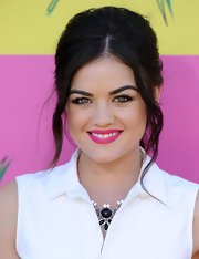 Lucy Hale's bright pink lip gave her an unexpected dash of color on the purple carpet at the KCAs.