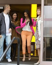 Kim Kardashian color-blocked these tangerine jeans with her hot pink blazer.