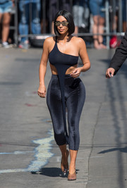 Kim Kardashian bared plenty of skin in a navy one-shoulder crop-top while headed to 'Kimmel.'