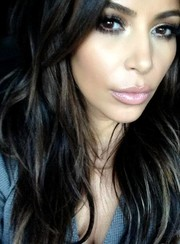 Kim Kardashian threw a pretty pink pout on social media.