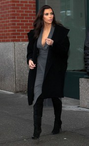 Kim Kardashian capped off her fierce ensemble with black knee-high boots by Alexander Wang.