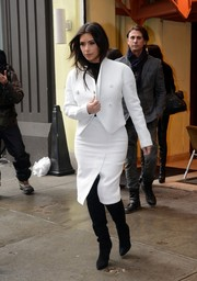 Kim Kardashian headed to a lunch date looking stylish in a white Proenza Schouler skirt suit and black Alexander Wang boots.