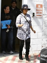 Kourtney Kardashian went shopping at Marc Jacobs in Beverly Hills wearing a pair of tall black suede boots with fringes.