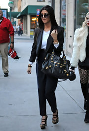 Kourtney showed off her chic style in round shades and a sharp blazer while out in NYC.