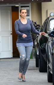 Kim Kardashian kept it low-key in a long-sleeve gray T-shirt by Rick Owens during a shopping trip.