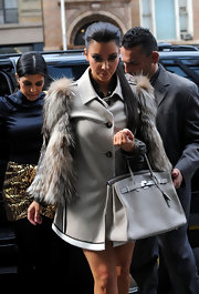 Kim looked ready for fall in a fur clad jacket. She completed her look with one of her many Birkin bags.