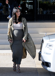 Tight dresses teamed with coats have become Kim Kardashian's signature. For a day of shopping, she wore this gray Wolford skirt (actually, a dress worn as a skirt) with an Isabel Marant trenchcoat.