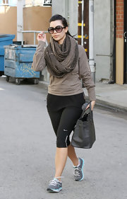 Kim Kardashian left the gym in a pair of gray and baby blue Skechers.