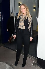 Kimberley Walsh was all bundled up in black skinny pants, a leather jacket and a scarf during her guest appearance at Heart FM.