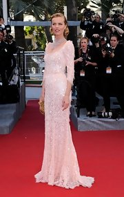 Eva Herzigova glittered at the Cannes Film Festival in this beaded blush lace gown.