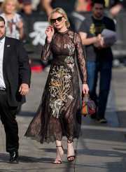Kirsten Dunst wowed in an embellished black lace dress by Valentino as she made her way to 'Jimmy Kimmel Live.'