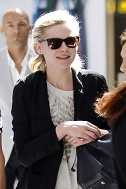 Kristen wore classic cateye shades. This is the ultra-feminine sunglasses shape.