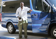 Seal kept things basic in a crisp white button-down shirt, which the singer with a pair of loose olive cargo pants.