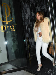 Larsa Pippen paired her coat with skintight white jeans.