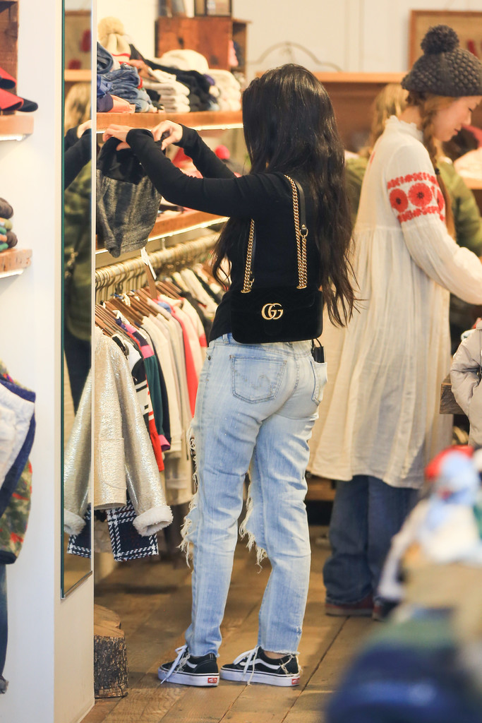 496110212e Kourtney Kardashian accessorized with an elegant black Gucci Marmont suede  bag while out shopping.