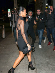 Kourtney Kardashian teetered on a pair of black patent stilettos by Saint Laurent while enjoying a night out.