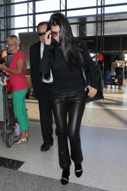 Kourtney Kardashian matched her top with a pair of black RtA leather pants.
