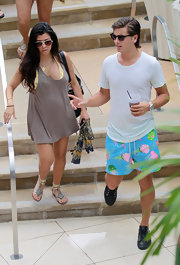 """Kourtney's """"Framed Aviator"""" sunglasses are plastic with a metal studded bar across the front. Perfect for Miami."""