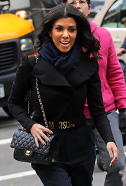 Kourtney has been steeping up her style game as of late. She  finished off her cozy cropped jacket and scarf with a quilted Flap bag.