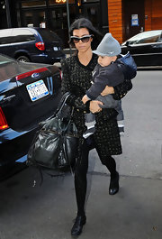 Kourtney Kardashian is a mom on the go. With son in tow, she carried her large leather tote bag while taking her son to music class.