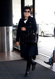 Kris Jenner chose this black wool coat for her classic-looking travel ensemble.