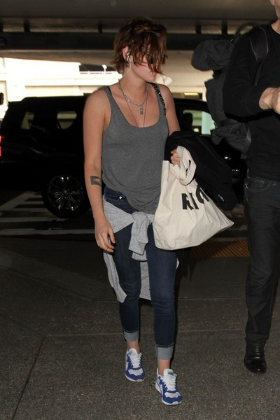 Kristen Stewart continued the relaxed vibe with a pair of two-tone sneakers.