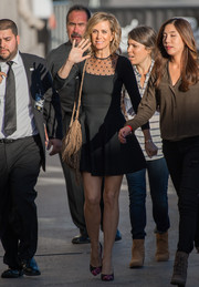 Kristen Wiig headed to 'Jimmy Kimmel Live' looking adorable in a sheer-panel black skater dress.