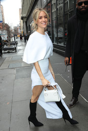 e7d8d5112ea9 Kristin Cavallari completed her ensemble with a white leather purse by  Versace.