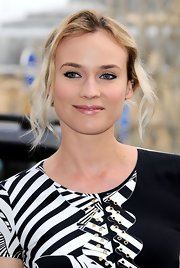 Diane Kruger wore a frosty pale pink lipstick at the Versace fashion show in Paris.