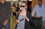 Kylie wore classic wayfarer sunglasses with a comfy travel look.