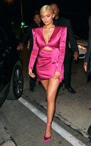 Kylie Jenner matched her dress with strappy satin pumps by Olgana Paris.