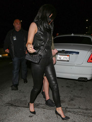 Kylie Jenner styled her look with a chic matelasse leather bag by Miu Miu.