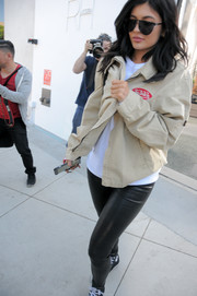 Kylie Jenner headed out in LA wearing half-moon shades by Sorella.
