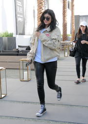 Kylie Jenner teamed her jacket with black leather leggings by J Brand.