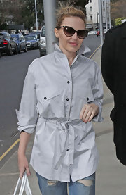 Singer Kylie Minogue looked causal cool wearing a pair of boyfriend jeans, a button up shirt and cat-eyed sunglasses.