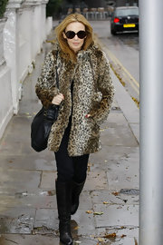 Kyle looks purrfect in round tortoiseshell shades paired with a faux leopard coat.