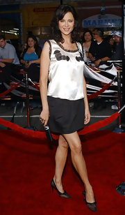 Catherine Bell completed her delightful ensemble with bow-embellished black mesh pumps.
