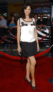 Catherine Bell attended the premiere of 'Mission: Impossible III' looking cute in an embroidered white tank top embellished with tiny black ruffles.