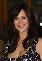 Catherine Bell styled her long hair in a layered cut with bangs for the premiere of 'Bruce Almighty.'