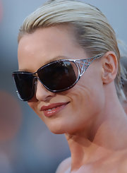 Nicollette Sheridan looked modern and glamorous in a pair of silver framed shield sunglasses.