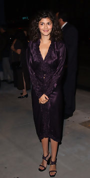Audrey smiles sweetly in a silk plum evening dress. The long sleeves and rich texture make this a unique piece.
