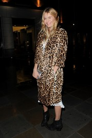 Sienna Miller matched a luxurious leopard-print fur coat with tough-looking black ankle boots for a night out in London.