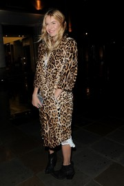Sienna Miller was spotted out and about in London wearing a luxe leopard-print fur coat.
