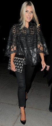 Mollie King polished off her look with dainty black patent pumps by Gucci.
